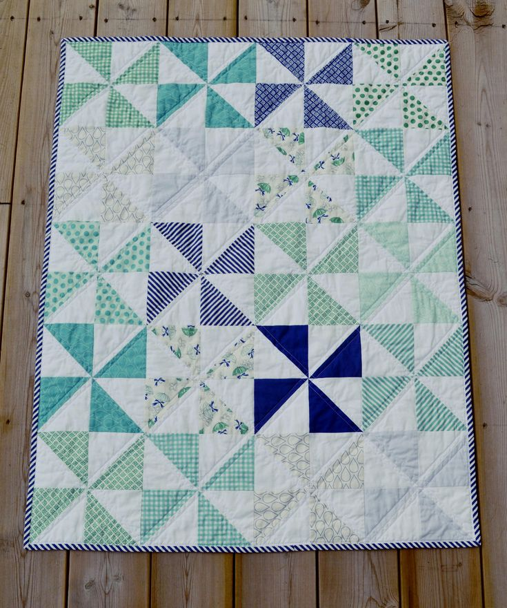 https://flic.kr/p/yrh9TT | Baby April Showers Pinwheel Quilt | This baby quilt features prints from the April Showers line by Bonnie & Camille for Moda Fabrics and is currently for sale on my etsy page.