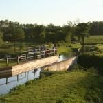 Walkers on the Wey & Arun Canal at Drungewick Aqueduct near Loxwood in West Sussex.