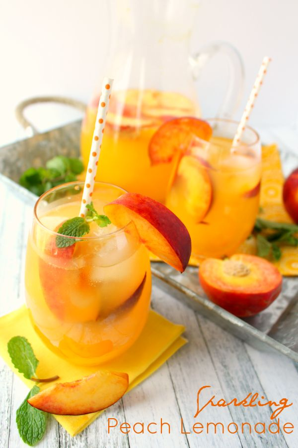 The perfect cold drink for sipping on a hot summer day! This delicious Sparkling Peach Lemonade is made with just a few simple ingredients and comes together in just minutes. Fantastic for picnics, parties and showers, too!