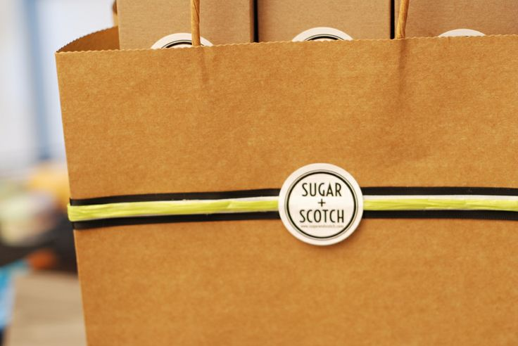 Simple, clean packaging.  Natural, black and bright green raffia.