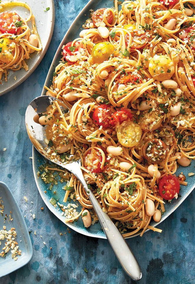 Ready in less than 30 minutes, this white bean and tomato pasta is topped with toasted bread crumbs for a bit of a crunch.