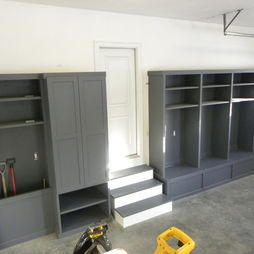garage design... love the deep pocket for rakes, shovels, etc. This is going in my garage!!