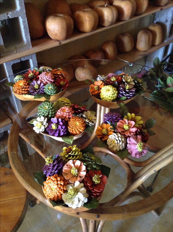 Painted pinecone flowers in gourd bowls
