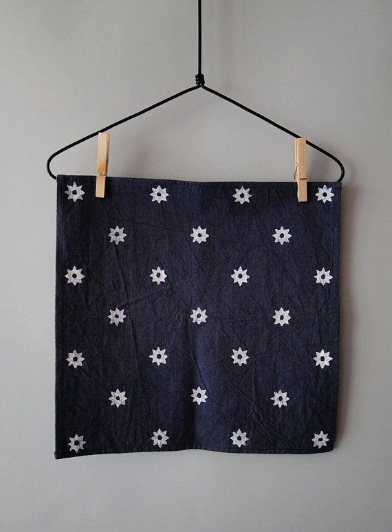 Star pattern is hand-printed on indigo + cochineal dyed cotton fabric using white non-toxic, water-based screen print ink
