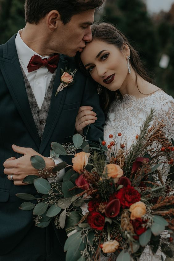 You can have a vintage enchanted forest wedding. This couple picked burgundy and copper hues gor their woodland wedding.