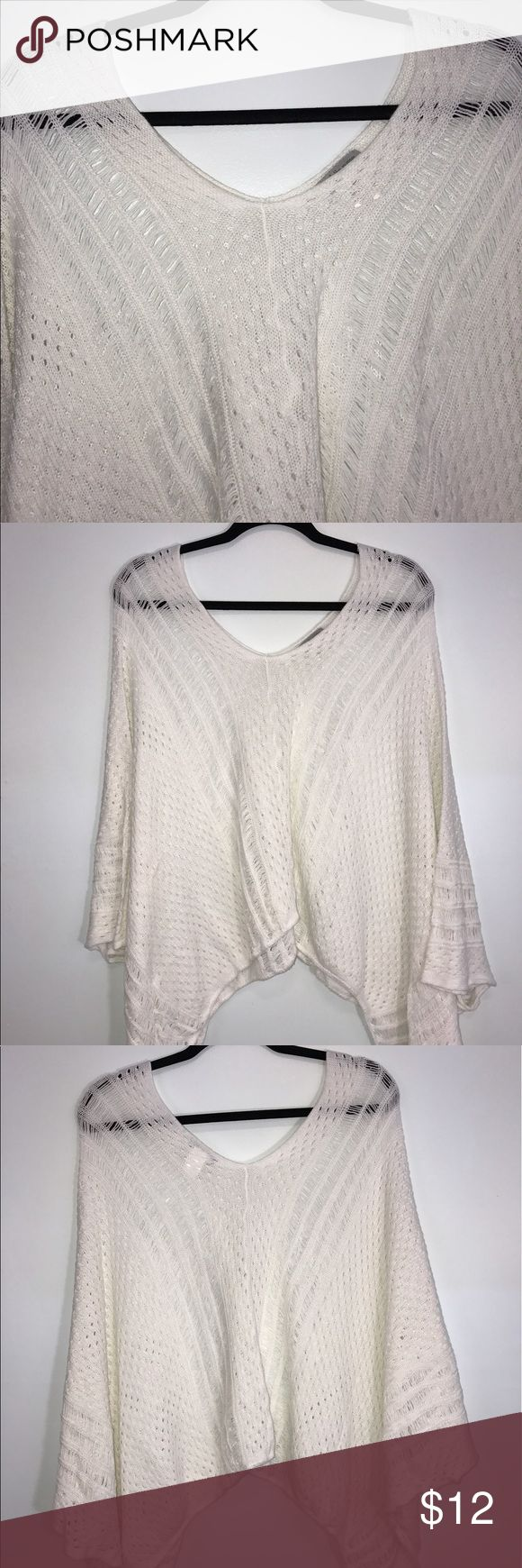 """Charlotte Russe Cream Knit Cape L/XL Charlotte Russe Cream knit cape/poncho. Lying flat, approximate measurements are: width 46""""; length 20"""". (K01-14)    🌼No holes, piling or stains. Items stored in smoke free, pet free, perfume free environment. No trades or modeling. Same or next day shipping.  Save by bundling. All offers should be submitted with the offer button. Charlotte Russe Sweaters Shrugs & Ponchos"""