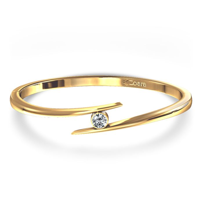 Shop Round Brilliant Bezel Set Single Diamond Bangle in 14k Yellow Gold