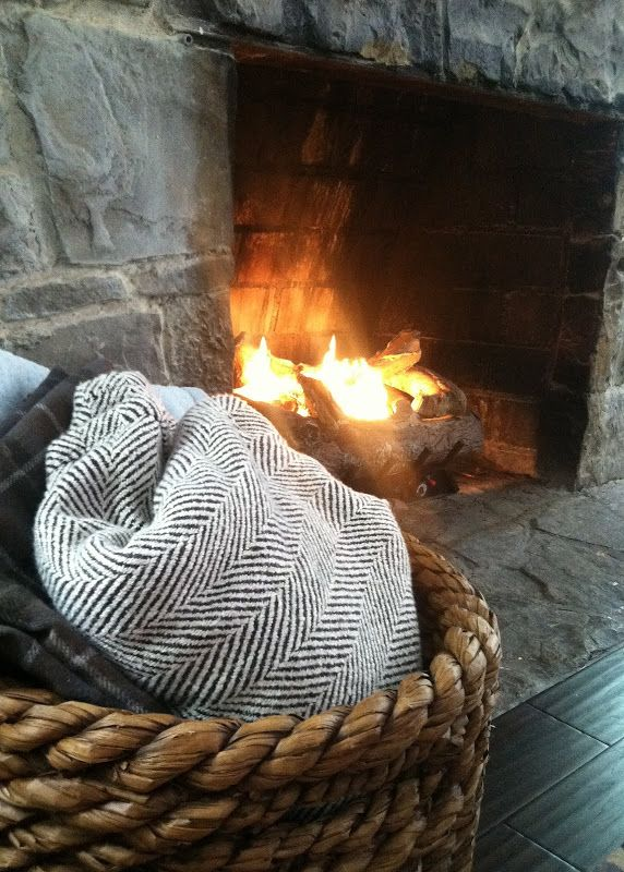 Basket of Blankets Near the Fireplace