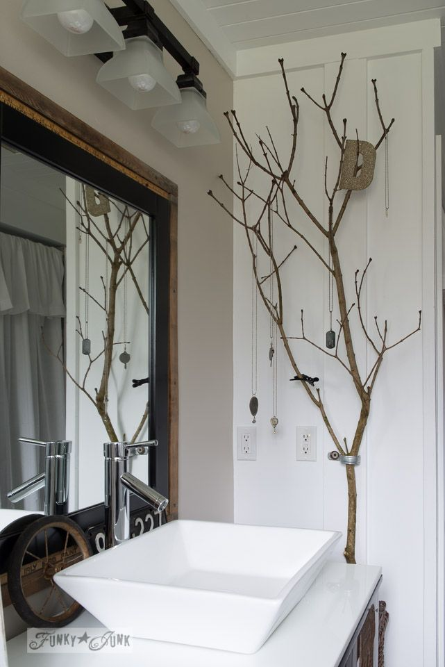 branch jewelry holder in bathroom - what a fun idea! Salvaged farmhouse bathroom makeover via www.funkyjunkinte...