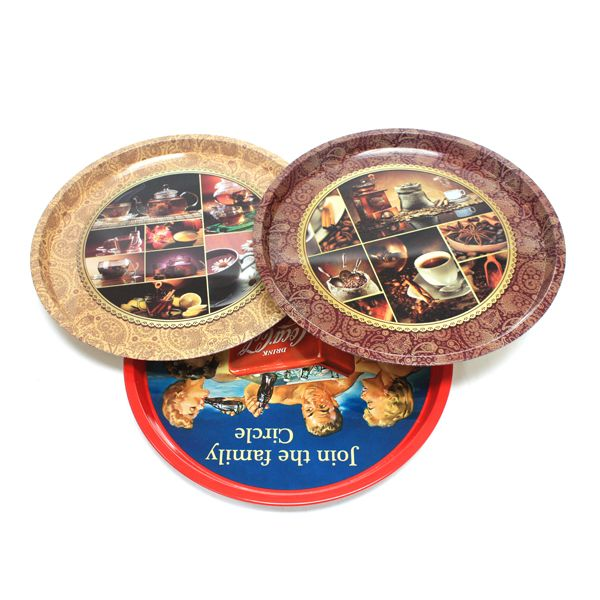 This premium round serving tin tray looks good and feels good.