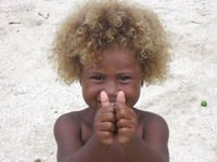 Point mutation in Indonesia causes blond hair.  Very cool study.