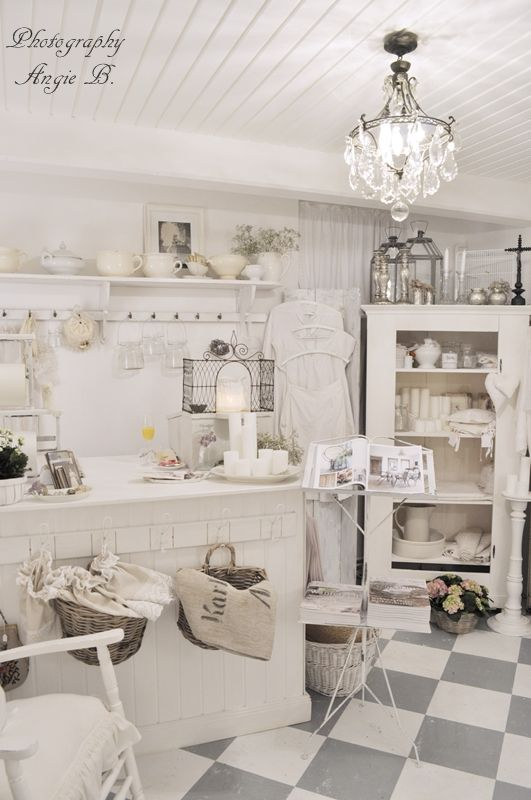 French Shabby Chic retail shop , love these grey checkerboard floors