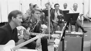 James Burton and Glen Campbell were  members of a group of several L.A. studio musicians in the 1960`s who have since been dubbed- The Wrecking Crew
