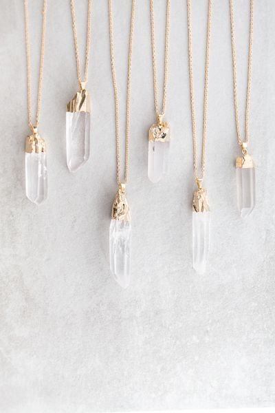 Long clear quartz pendant necklace.