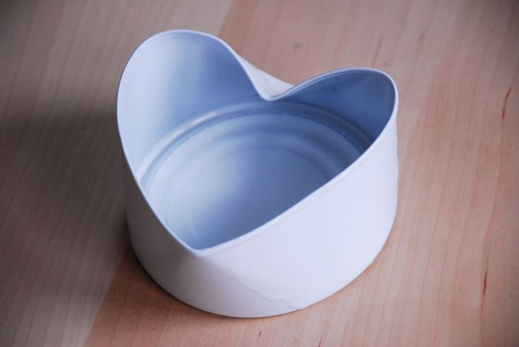 """The """"Uncanny Heart"""" Bowl - large tuna can bent to shape and spray-painted."""