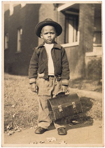 Photograph of boy with lunchbox. George Washington Watkins Family Papers, c1890—1980