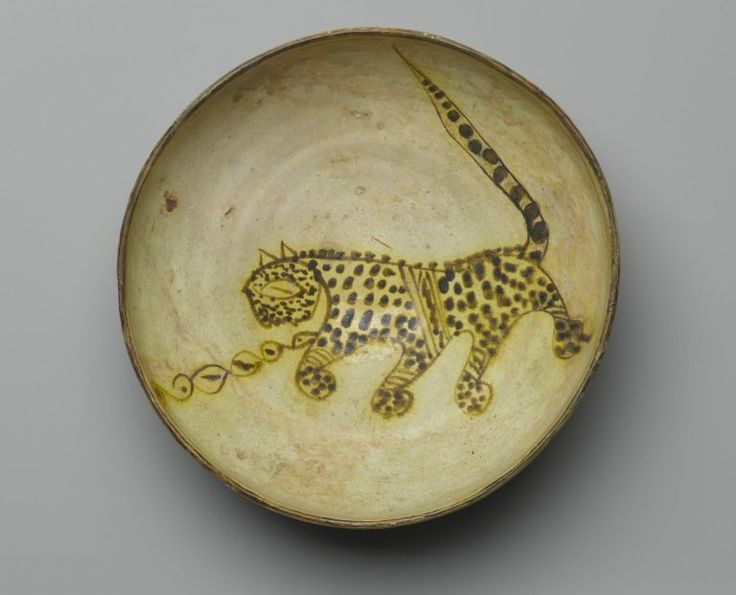 Bowl Depicting a Cheetah, 10th century. Ceramic; earthenware, painted in yellow-staining black slip on a white slip ground under a transparent glaze, 8 5/8 in. (21.9 cm). Brooklyn Museum, Frederick Loeser Fund, 73.165. Creative Commons-BY (Photo: Brooklyn Museum, 73.165_top_PS2.jpg)