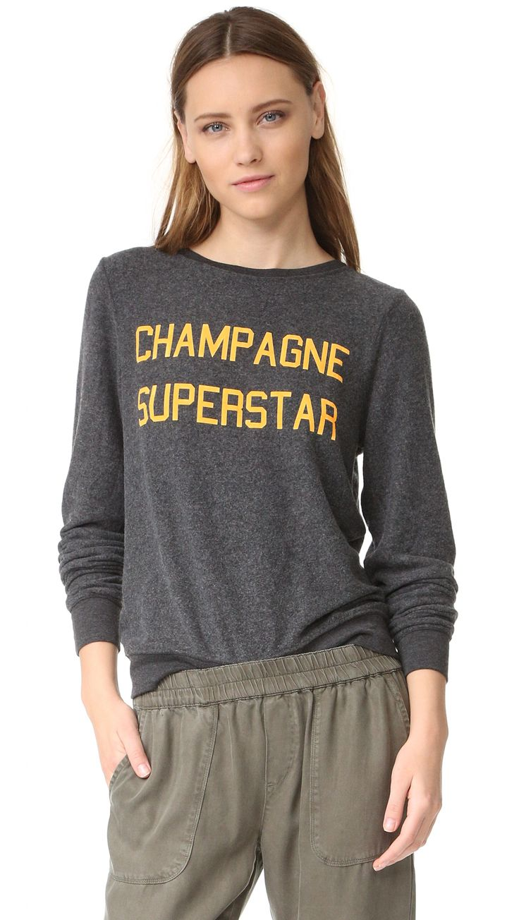 Buy it now. Wildfox Champagne Superstar Sweatshirt - Clean Black. A cozy fleece Wildfox pullover with neon 'Champagne Superstar' lettering in front. Relaxed crew neckline. Long sleeves. Fabric: Reverse fleece. 47% polyester/47% rayon/6% spandex. Wash cold. Made in the USA. Measurements Length: 23.5in / 60cm, from shoulder Measurements from size S. Available sizes: L , deportivas, sport, deporte, deportivo, fitness, deportivos, deportiva, deporte, courtvantage, stansmith, superstar…