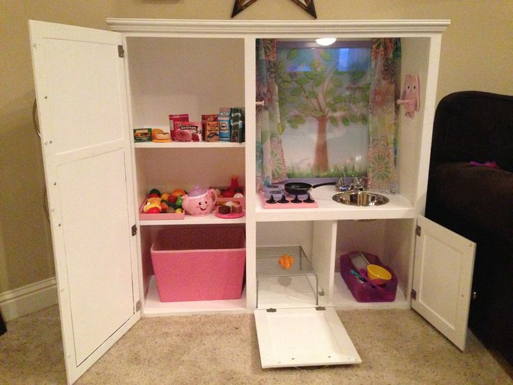 Kids kitchen upcycled from old oak entertainment center for Upcycled entertainment center