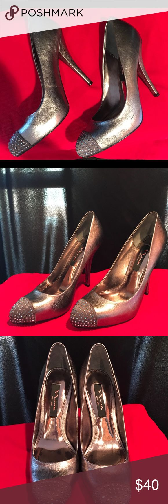 Elegant Silver Nina pumps size 7.5M Perfect for the Holidays!!!  Tasteful diamond detail to shine at the party without being over the top. Very good condition. A few minor dents, almost invisible. Nina Shoes Shoes Heels