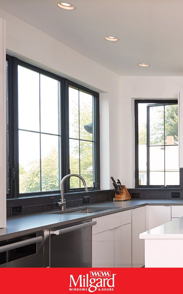 Striking Black Windows Are The New Trend For Kitchens The Sleek Black Frame Complements A Moder Contemporary Windows Black Window Frames Kitchen Island Design