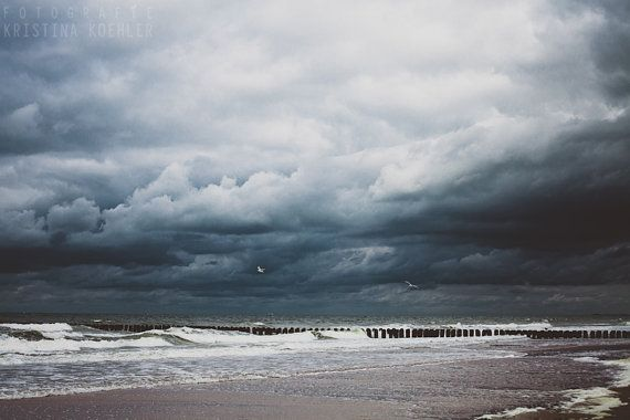 Signed photography print Stormy Seas. Size 8x12 inches.    STORMY SEAS: The beach lies deserted as the storm clouds roll in.