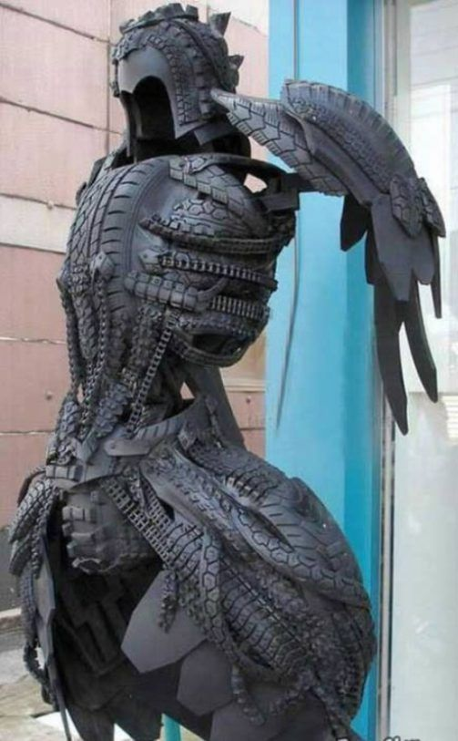WHOA! Tire Armor. Now I know what to do with all those old bike tires. I would drill holes in the pieces and rivet them together or rivet to straps that hold everything together