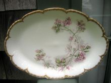 Antique Haviland Limoges Platter With Hand Painted Accents  On The Double Gold Trimmed Blank #418  Haviland pattern features a spray of lavender pink flowers along with green leaves flowing up one side of this platter.  This pattern is on a beautiful double heavy gold trimmed embossed and scalloped blank and is finished with hand painted accents.  Back stamp is shown and this mark was used c.1894-1931. This china was made especially for Bailey Banks and Biddle Philadelphia  $80.00Pink Flower, Hands Painting, Green Leaves, Limoges Platters, Haviland Limoges, Antiques Haviland, 80 00, Baileys Banks, Platters Hands