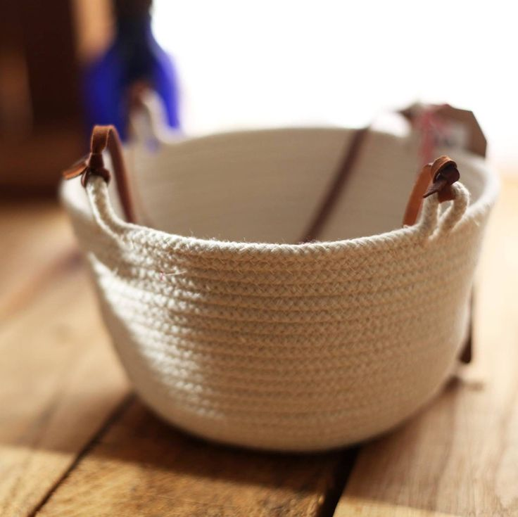 """Our latest hanging baskets are tiny and adorable. These 6"""" baskets strung with dark brown leather are just waiting for the right little plant to hang in your window or under your kitchen cabinets. Pick one up now to get it in time for the holidays!"""