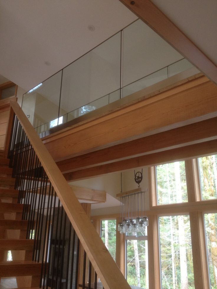 Custom laminated / tempered catwalk freestanding in shoe with S.S. cladding.
