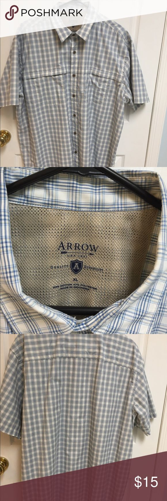 Men' s Arrow short sleeve shirt New without tags Arrow shirt. Blue, tan and off white plaid design. Has two front pockets with velcro closing. Arrow Shirts Casual Button Down Shirts