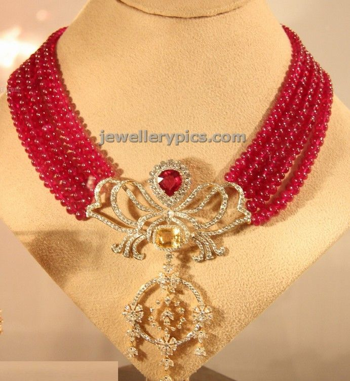5 layer ruby beads necklace with lotus pendent - Latest Jewellery Designs