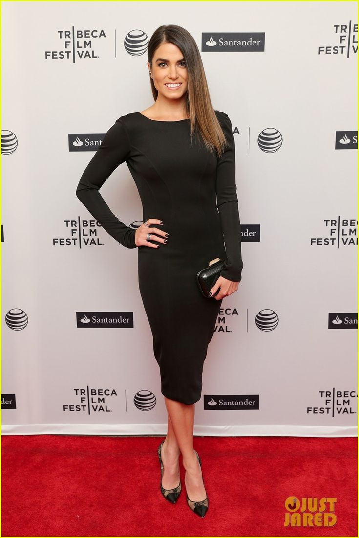 Nikki Reed's tight black dress shows off all her assets on ...