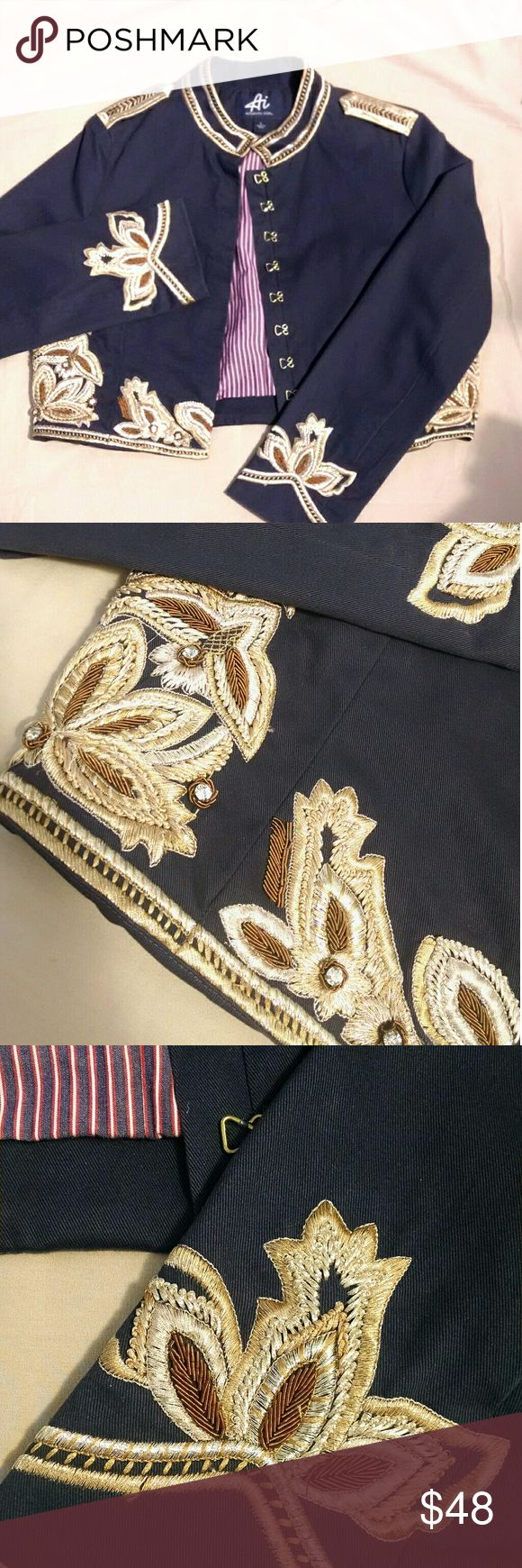 NWOT Authentic Icon Embroidered Military Jacket Never worn! Stunning navy military jacket in a cropped style from the Authentic Icon line, features gorgeous gold embroidery and beading with white crystal accents and vertical striped navy, red, and white lining. Also features gold metal hook-and-eye closures and embroidered epaulets.   Minor imperfections in the embroidery work, which is expected for such intricate threading and how the garment was purchased. Small,  hardly noticeable pulls…