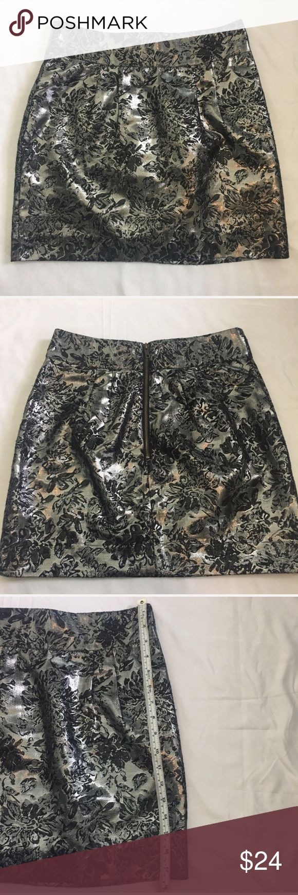 🎀3 For $3o Urban Outfitters Metallic Skirt Size 8 Urban Outfitters Silence +Noise silver metallic skirt. Floral print. Back zipper. Good used condition. No rips or stains. Size 8. Length approximately 17 1/2 inches. 40% cotton/30%polyester/30% acrylic Urban Outfitters Skirts Mini