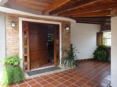 puertas de entrada principal de madera cerca amb google