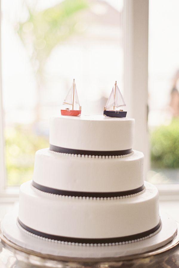 beachy nautical wedding cake sailboat topper