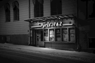 Claes Eklund - Fyris Biografen. Black and white image of the old movie theatre Fyris in Uppsala. Available as poster and laminated picture at Printler, the marketplace for photo art.