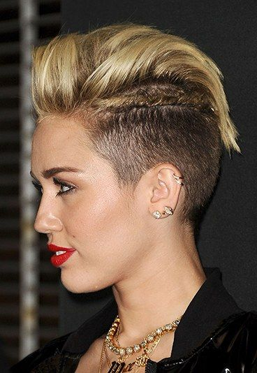 Miley rocks the faux hawk with shaved sides and braids.
