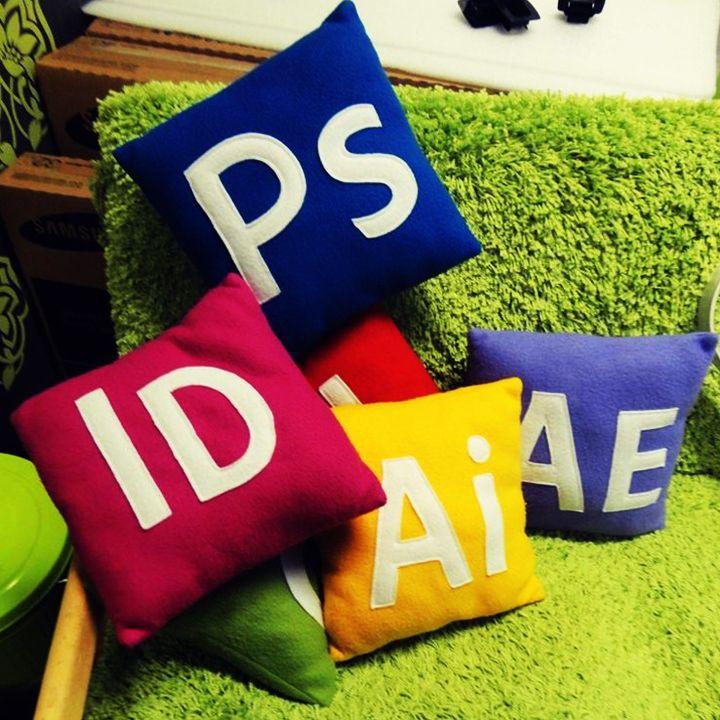 Adobe Creative Cloud pillow cushions.