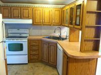 Roughly $150 kitchen makeover (mobile home) painting fake wood cabinets