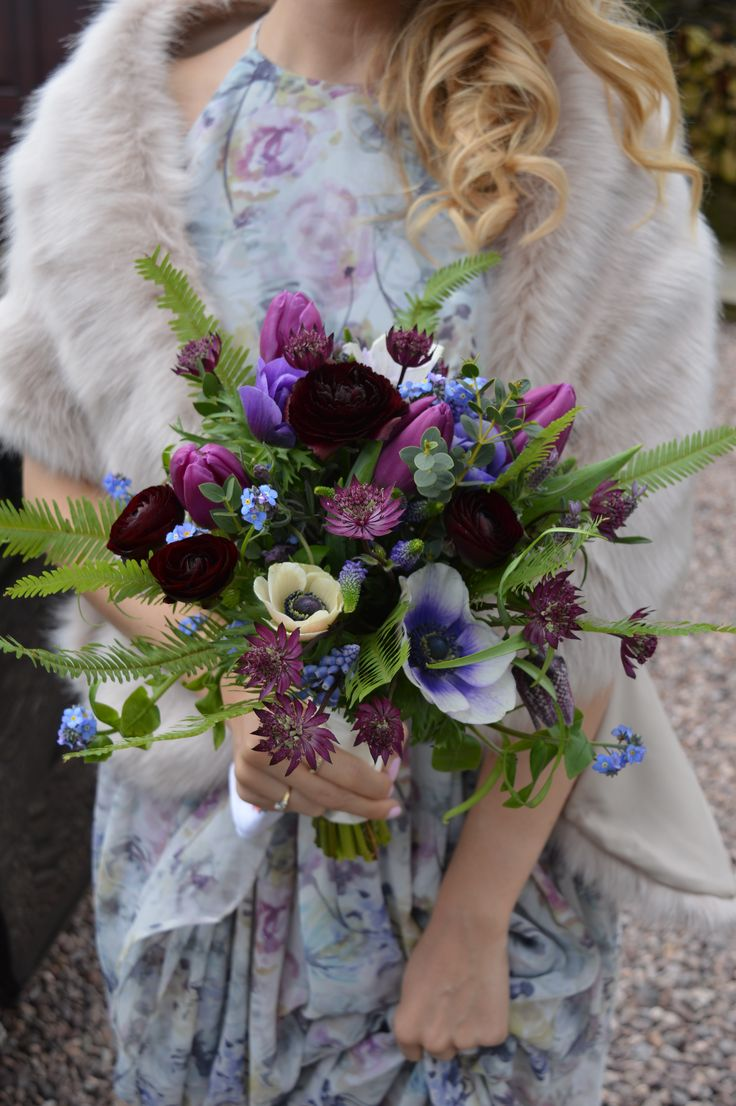Spring flower, vintage style wedding bouquet using a lilac, purple, magenta, blue colour scheme highlighted with ferns. Ranunculus, anemones, forget-me-nots, tulips and astrantia
