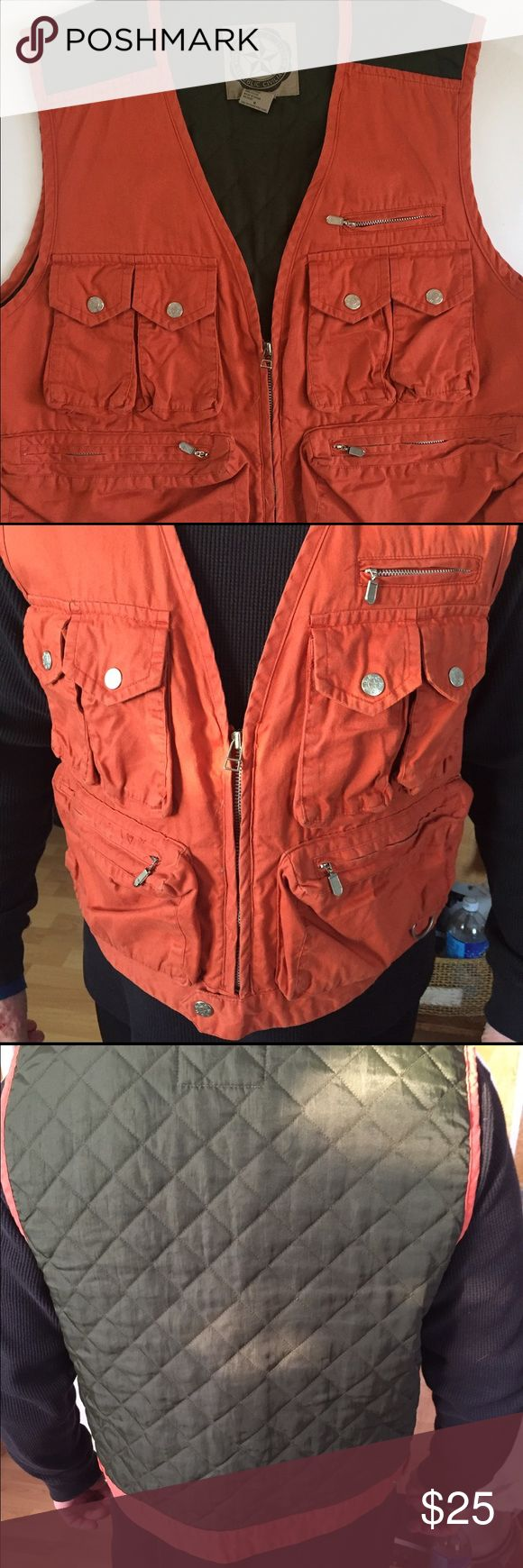 Banana Republic Safari Vest Medium sized vest lots of front pockets for photo supplies or fishing or a safari. !! Good preowned condition.  Size men's medium. Banana Republic Suits & Blazers Vests