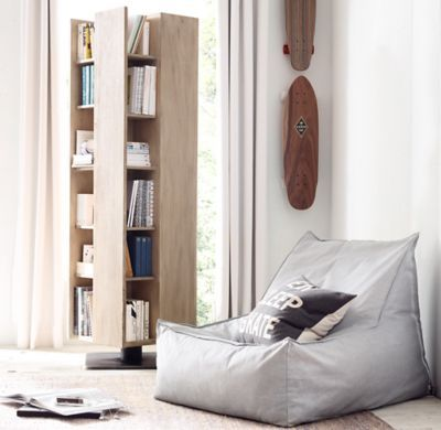 RH TEEN's Distressed Canvas Bean Bag Lounger :Version 2.0. Our relaxed lounger is a new take on the classic bean bag silhouette with its raised back and roomy seat. Covered in machine-washable canvas, it's filled with a body-conforming bead insert that cradles you in comfort.