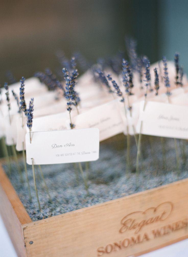 Escort cards displayed on lavender stems 125