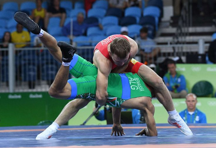 Ruslan Tsarev of Kyrgyzstan, top, competes against Tarek Aziz Benaissa of Algeria during the men's wrestling Greco-Roman 66kg 1/8 final in the Rio 2016 Summer Olympic Games at Carioca Arena 2.     -   Rio Olympics: Best images from Tuesday, Aug. 16