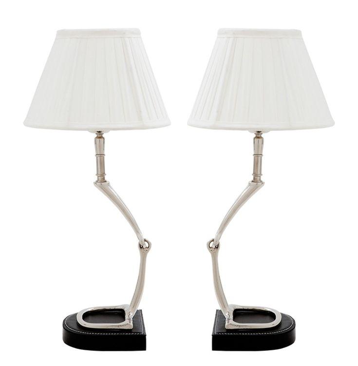 Этот набор из двух настольных ламп - отличный вариант для оформления парных поверхностей в интерьере - например, прикроватных тумб в спальне, но так же можно установить по двум сторонам комода, камина, консоли. Лампы с оригинальным основанием из металла со вставками из натуральной кожи и классическими белоснежными абажурами отлично впишутся в современно оформленные пространства.<div><br></div><div>Цена указана за одну лампу. Набор из 2 ламп Материал: металл, натуральная кожа</div>