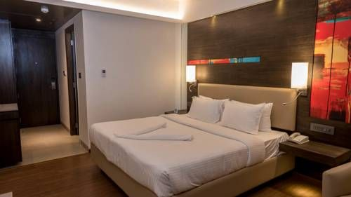 V Hotel Visakhapatnam V Hotel is located in Visakhapatnam, 6 km from Indira Gandhi Zoological Park and 500 metres from Diamond Park. Guests can enjoy the on-site restaurant. Free private parking is available on site.  The rooms are equipped with a flat-screen TV.