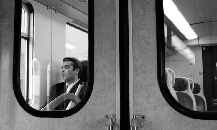 https://flic.kr/p/HKGMmS | Giulia Bergonzoni #photography #fine #art #street #photographer #train #station #doors #glass #sleeping #passenger #man #boy #giulia #bergonzoni #black #white #travel