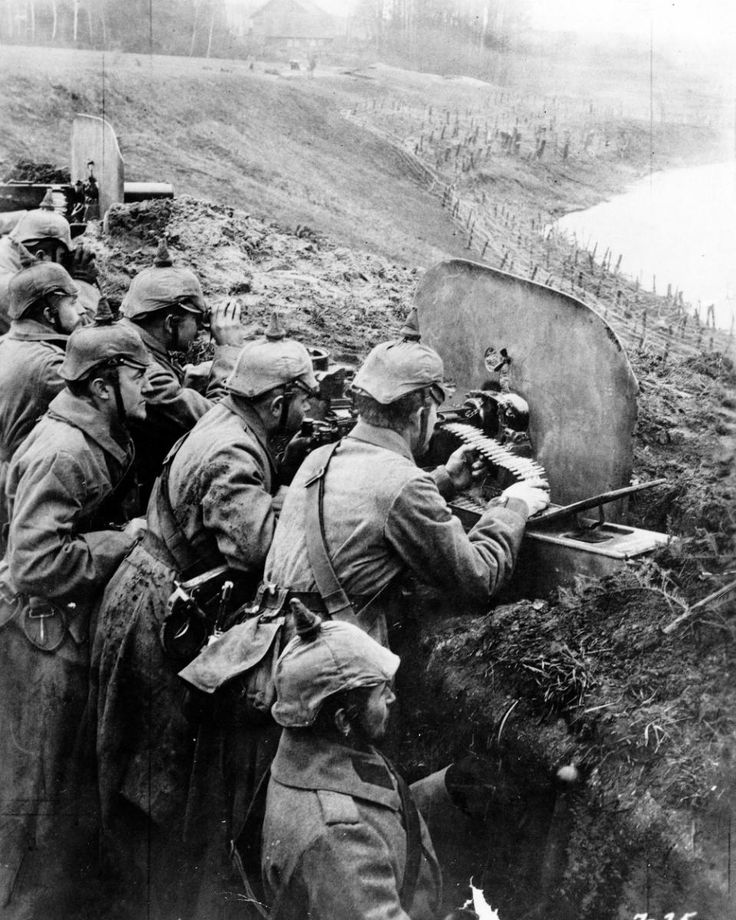 In this 1916 file photo, German troops man a machine gun post from a trench at the Vistula River in Russia during World War One.
